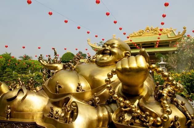 Travel money - Golden Buddha at Da Nam, Vietnam