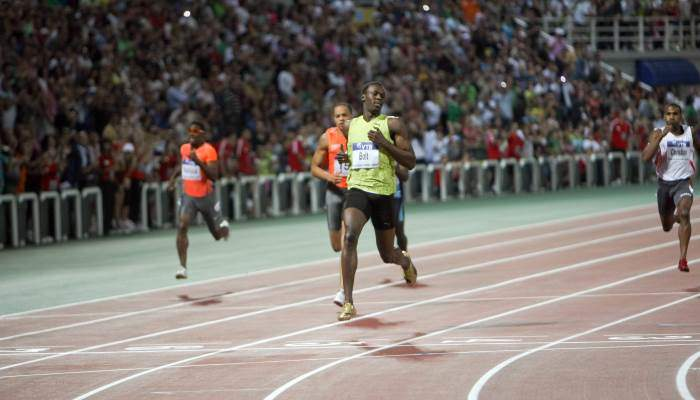 usain-bolt-competing-in-100m-race-olympics