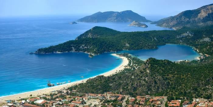 aerial shot of the blue lagoon, olu deniz, kumburnu public beach and mount babadag on Turkey's turquoise coast