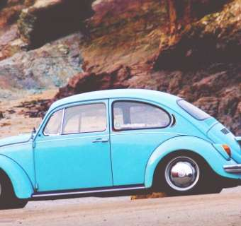 classic blue car on beach