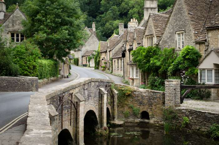 Classic Cotswold village with bridge over a stream