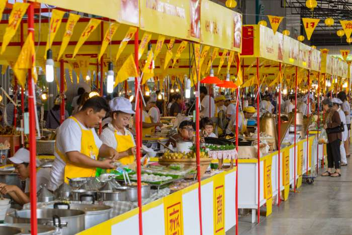 Street vendors selling food with yellow flags