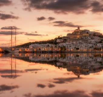 Old Town Ibiza across the water with sailing boat