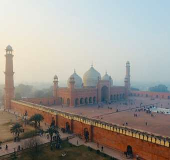 Aerial view of Badshahi Mosque, Lahore, seen in the morning mist