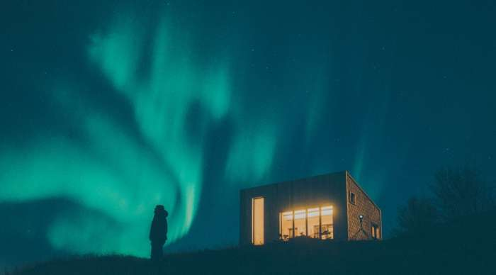 View of the Arctic Hideaway beneath the Northern Lights