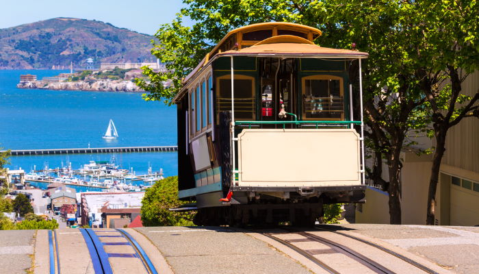 Tram coming over hill overlooking San Francisco Bay