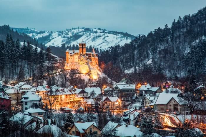 Bran Castle in Romania in the snow at night
