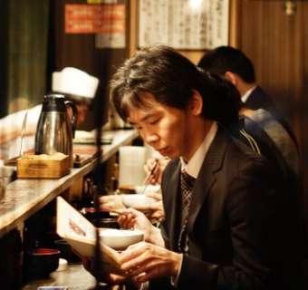 Man reading in restaurant in Tokyo
