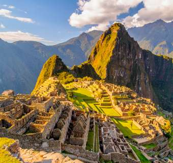 Aerial view of Machu Picchu at golden hour