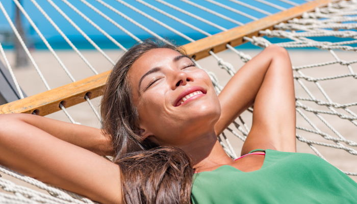 Girl smiling and relaxing on hammock