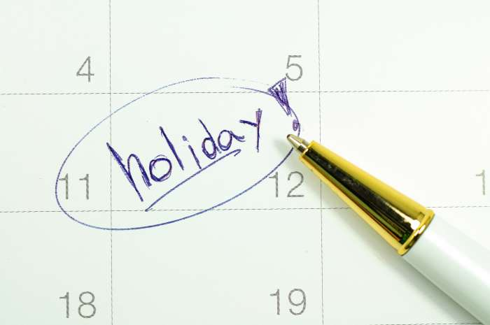 The word 'holiday' marked on a calendar