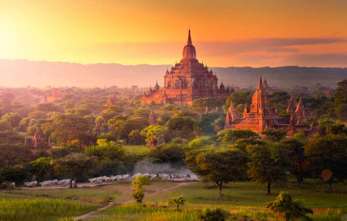Ancient pagodas seen on the plain of Bagan, Myanmar, at sunrise