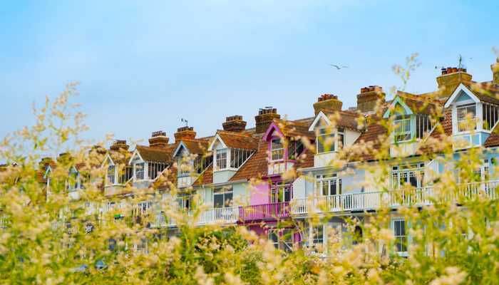 picture of brightly coloured houses on the seafront in Whitstable