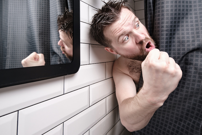 Man getting angry while in shower