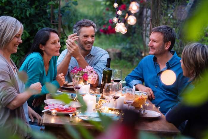 Friends enjoying conversation after dinner