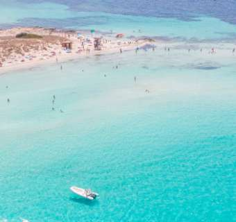 A boat in the azure waters of Formentera