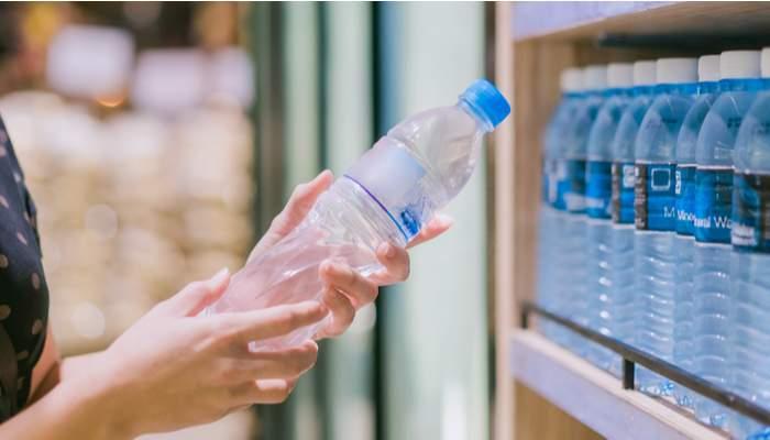 Choosing a bottle of water in a shop