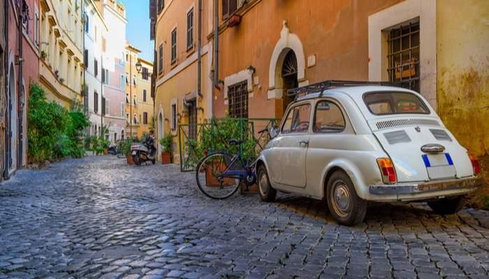mini car on cobbled Rome street