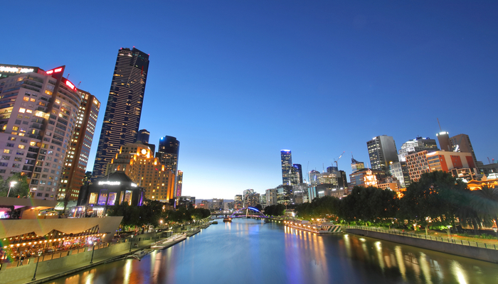 Picture of skyscrapers beside a waterway at night in Melbourne, Australia