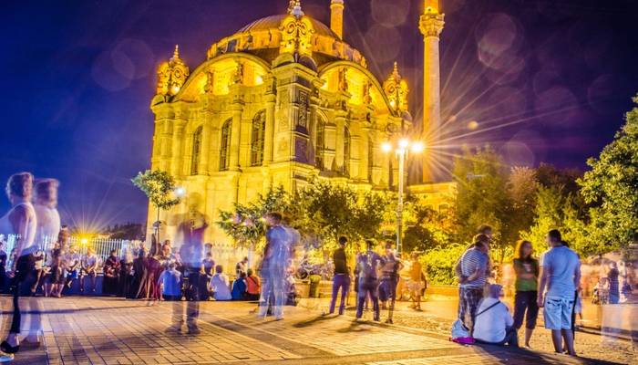 Istanbul nightlife featuring a religious building and people socialising
