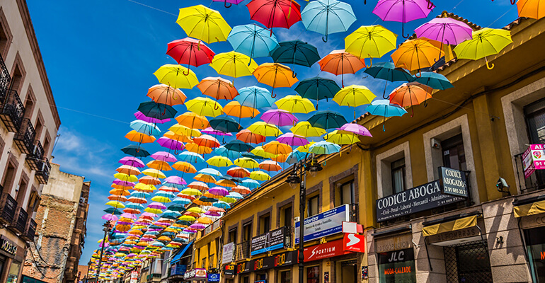 Bright umbrellas cover a street in Madrid
